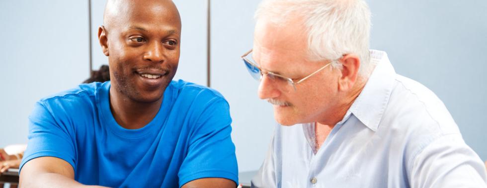 young man and senior man having conversation