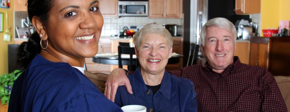 caregiver and couple senior smiling